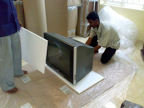 packing TV by a packers and movers